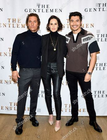 """Matthew McConaughey, Michelle Dockery, Henry Golding. Actors Matthew McConaughey, left, Michelle Dockery and Henry Golding pose together during photo call for the film """"The Gentlemen"""" at The Whitby Hotel, in New York"""