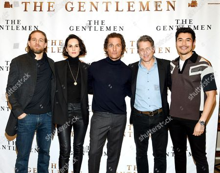 "Charlie Hunnam, Michelle Dockery, Matthew McConaughey, Hugh Grant, Henry Golding. Actors, from left, Charlie Hunnam, Michelle Dockery, Matthew McConaughey, Hugh Grant and Henry Golding pose together during photo call for the film ""The Gentlemen"" at The Whitby Hotel, in New York"