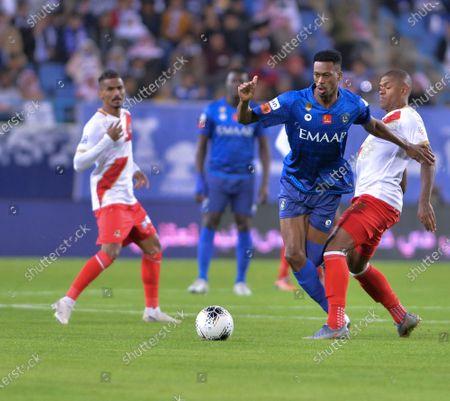 Al-Hilal's Mohamed Ibrahim kanno (L) in action against AL- Wehda's Anselmo de Moraes (R) during the Saudi Professional League soccer match between AL- Wehda and Al-Hilal at King Saud University Stadium, Riyadh, Saudi Arabia, 11 January 2020.