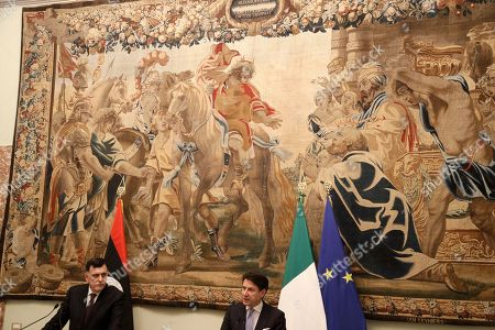 Libya's Prime Minister Fayez al-Sarraj, left, holds a joint press conference with Italian Premier Giuseppe Conte after their meeting at Chigi palace, in Rome