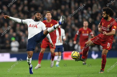 Tottenham Hotspur's Danny Rose (L) in action with Liverpool's Mohamed Salah (R) during the English Premier League soccer match between Liverpool and Tottenham Hotspur held at Tottenham Hotspur Stadium in north London, Britain, 11 January 2020.