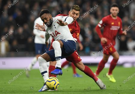 Tottenham Hotspur's Danny Rose (L) in action with Liverpool's Roberto Firmino (R) during the English Premier League soccer match between Liverpool and Tottenham Hotspur held at Tottenham Hotspur Stadium in north London, Britain, 11 January 2020.