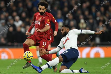 Tottenham Hotspur's Danny Rose (R) in action with Liverpool's Mohamed Salah (L) during the English Premier League soccer match between Liverpool and Tottenham Hotspur held at Tottenham Hotspur Stadium in north London, Britain, 11 January 2020.