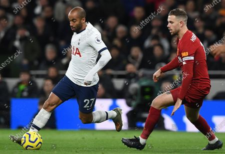 Tottenham Hotspur's Lucas Moura (L) in action with Liverpool's Jordan Henderson (R) during the English Premier League soccer match between Liverpool and Tottenham Hotspur held at Tottenham Hotspur Stadium in north London, Britain, 11 January 2020.
