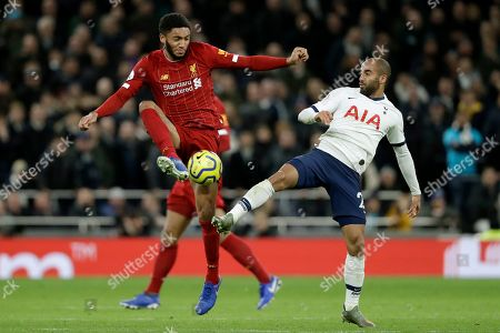Tottenham's Lucas Moura vies for the ball with Liverpool's Joe Gomez, left, during the English Premier League soccer match between Tottenham Hotspur and Liverpool at the Tottenham Hotspur Stadium in London, England