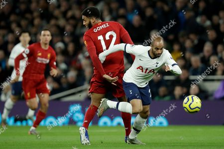 Tottenham's Lucas Moura, right, vies for the ball with Liverpool's Joe Gomez during the English Premier League soccer match between Tottenham Hotspur and Liverpool at the Tottenham Hotspur Stadium in London, England
