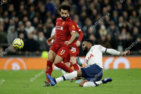 Tottenham's Danny Rose tackles Liverpool's Mohamed Salah, left, during the English Premier League soccer match between Tottenham Hotspur and Liverpool at the Tottenham Hotspur Stadium in London, England
