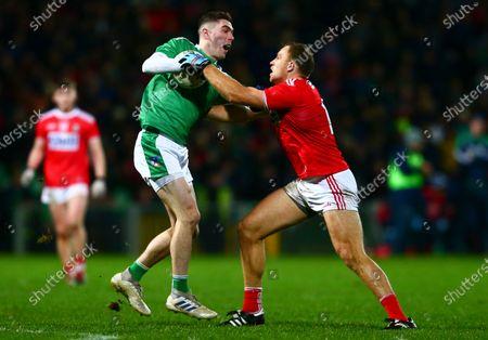 Cork vs Limerick. Cork's Ciaran Sheehan tackles Limerick's Paul Maher