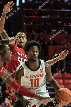 Illinois' Andres Feliz (10) is pressured by Rutgers' Shaq Carter(13) and Jacob Young (42) in the first half of an NCAA college basketball game, in Champaign, Ill