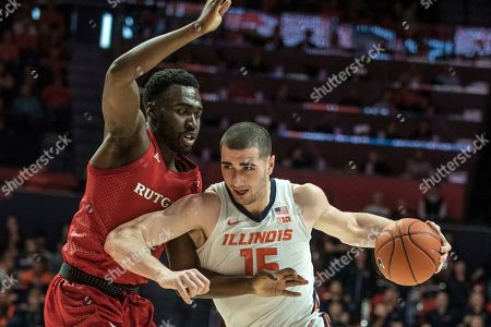 Illinois' Giorgi Bezhanishvili (15) tries to power past Rutgers' Shaq Carter (13) in the first half of an NCAA college basketball game, in Champaign, Ill