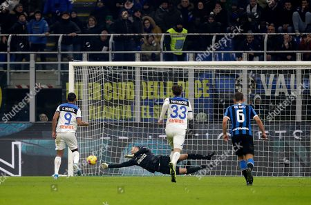 Stock Photo of Inter Milan's goalkeeper Samir Handanovic makes a save in front of Atalanta's Luis Muriel, left, from the penalty spot during the Serie A soccer match between Inter Milan and Atalanta at the San Siro stadium in Milan, Italy