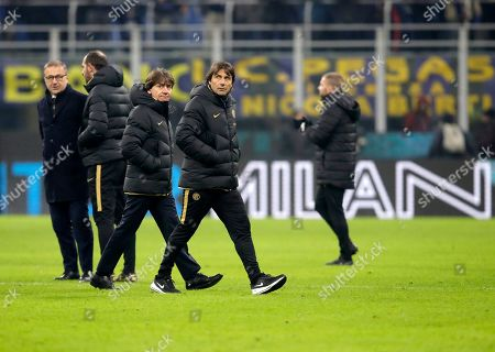 Inter Milan's head coach Antonio Conte, center, leaves the field after the Serie A soccer match between Inter Milan and Atalanta at the San Siro stadium in Milan, Italy