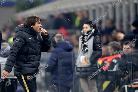 Inter Milan's head coach Antonio Conte leaves the field after the Serie A soccer match between Inter Milan and Atalanta at the San Siro stadium in Milan, Italy