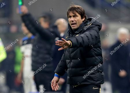 Inter Milan's head coach Antonio Conte gives instructions to his players during the Serie A soccer match between Inter Milan and Atalanta at the San Siro stadium in Milan, Italy