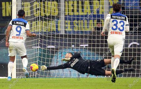 Inter Milan's goalkeeper Samir Handanovic saves a penalty kicked by Atalanta's Luis Muriel (L) during the Italian Serie A soccer match  Fc Inter vs Atalanta Bc  at Giuseppe Meazza stadium in Milan, Italy, 11 January 2020.
