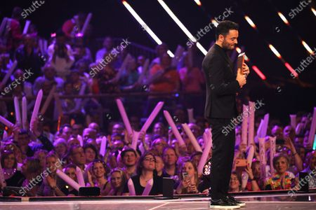 Stock Picture of Giovanni Zarrella holds the new artist prise on stage during the TV show 'Schlagerchampions 2020 - Das grosse Fest der Besten' (lit. The Big Festival of the Best) in Berlin, Germany, 11 January 2020.