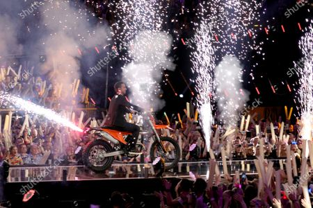 Florian Silbereisen arrives on stage with a motorcycle during the TV show 'Schlagerchampions 2020 - Das grosse Fest der Besten' (lit. The Big Festival of the Best) in Berlin, Germany, 11 January 2020.