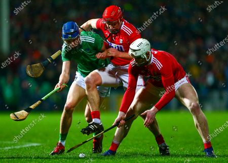Stock Picture of Cork vs Limerick. Limerick's David Reidy in action against Cork's Chris O'Leary and Bill Cooper