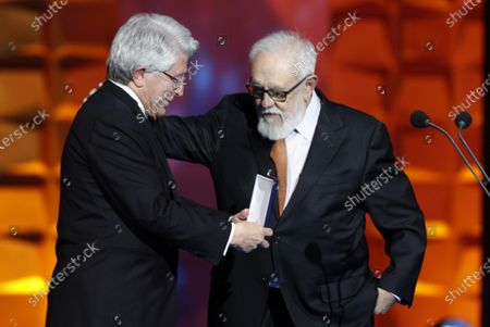 Enrique Cerezo (L) gives the Gold Medal Forque Award to Spanish film director and producer Gonzalo Suarez (R) during the gala of the 25th Forque Awards held at IFEMA Convention and Exhibition Center in Madrid, Spain, 11 January 2020.