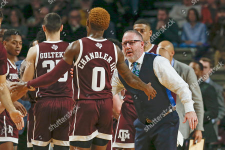 Texas A&M head coach Buzz Williams congratulates guard Jay Jay Chandler (0) during a timeout in the first half of an NCAA college basketball game against Vanderbilt, in Nashville, Tenn