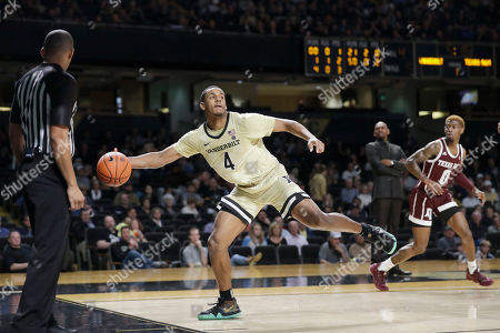 Vanderbilt guard Jordan Wright (4) saves the ball from going out of bounds in the first half of an NCAA college basketball game against Texas A&M, in Nashville, Tenn