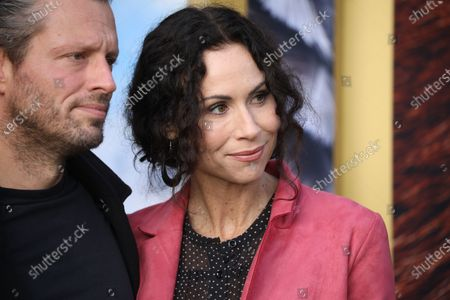 Stock Photo of Minnie Driver (R) and fiancé Addison Odea and son Henry Story Driver pose on the red carpet prior to the premiere of 'Dolittle' at the Regency Village Theater in Los Angeles, California, USA, 11 January 2020.