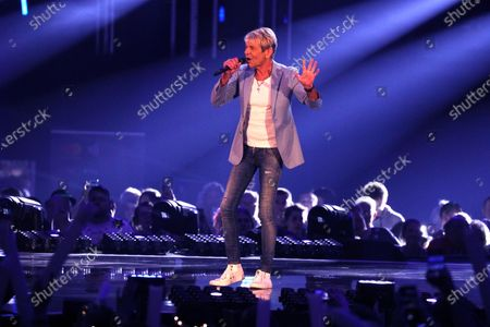 Stock Photo of Matthias Reim on stage during the TV show 'Schlagerchampions 2020 - Das grosse Fest der Besten' (lit. The Big Festival of the Best) in Berlin, Germany, 11 January 2020.