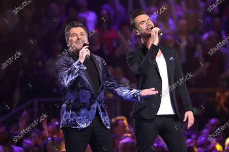 Thomas Anders (L) and Florian Silbereisen on stage during the TV show 'Schlagerchampions 2020 - Das grosse Fest der Besten' (lit. The Big Festival of the Best) in Berlin, Germany, 11 January 2020.
