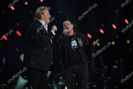 Kerstin Ott (R) and Howard Carpendale (L) on stage during the TV show 'Schlagerchampions 2020 - Das grosse Fest der Besten' (lit. The Big Festival of the Best) in Berlin, Germany, 11 January 2020.