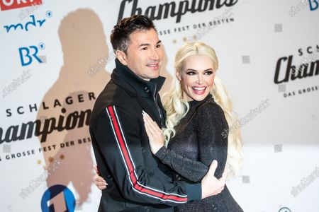 Lucas Cordalis (L) and television personality Daniela Katzenberger (R) pose on the red carpet before the TV show 'Schlagerchampions 2020 - Das grosse Fest der Besten' (lit. The Big Festival of the Best) in Berlin, Germany, 11 January 2020.