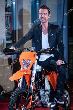 Florian Silbereisen rides a motorcycle on the red carpet before the TV show 'Schlagerchampions 2020 - Das grosse Fest der Besten' (lit. The Big Festival of the Best) in Berlin, Germany, 11 January 2020.
