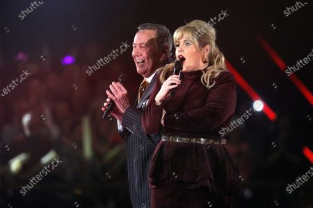 Maite Kelly (R) and Roland Kaiser (L) on stage during the TV show 'Schlagerchampions 2020 - Das grosse Fest der Besten' (lit. The Big Festival of the Best) in Berlin, Germany, 11 January 2020.