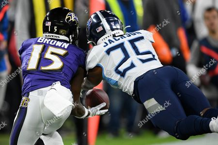 Baltimore Ravens wide receiver Marquise Brown (15) works for a catch against Tennessee Titans cornerback Adoree' Jackson (25) during the first half an NFL divisional playoff football game, in Baltimore