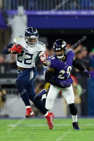 Tennessee Titans running back Derrick Henry (22) runs against Baltimore Ravens free safety Earl Thomas (29) during the first half an NFL divisional playoff football game, in Baltimore