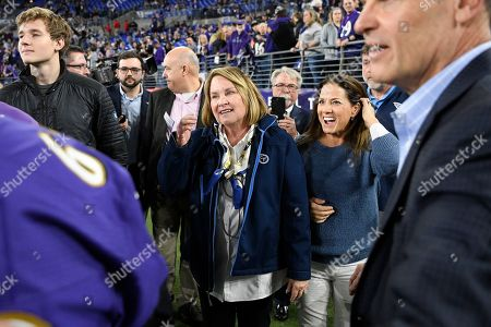 Titans controlling owner Amy Adams Strunk, center, speaks to people before an NFL divisional playoff football game between the Baltimore Ravens and the Tennessee Titans, in Baltimore
