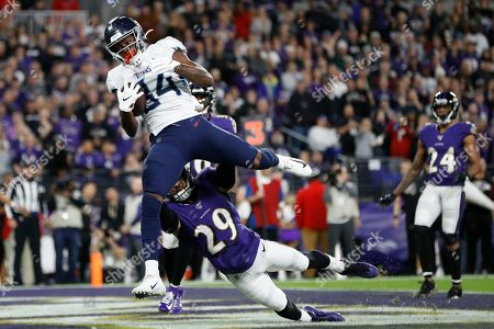 Tennessee Titans wide receiver Corey Davis (84) makes a touchdown catch against Baltimore Ravens free safety Earl Thomas (29) during the second half an NFL divisional playoff football game, in Baltimore