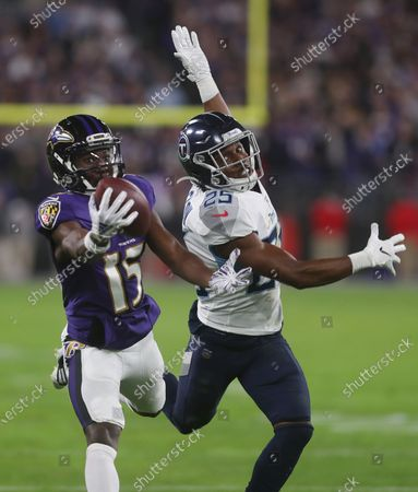 Baltimore Ravens wide receiver Marquise Brown (15) hauls in a long pass against the defense of Tennessee Titans cornerback Adoree' Jackson (25) to set up a field goal at the end of the first half of the AFC divisional playoff at M&T Bank Stadium in Baltimore, Maryland on Photo/ Mike Buscher / Cal Sport Media