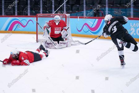 Ice Hockey 3on3 - Qualification Day 2, Lukas Floriantschitz (AUT/Black Team) shoots against Goalkeeper Matthias Bittner (GER/Red Team) and Matija Dinic (SRB/Red Team).