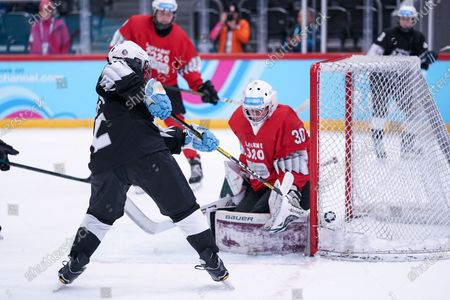 Ice Hockey 3on3 - Qualification Day 2, Junior Esposito (ARG/Black Team) scores against Goalkeeper Matthias Bittner (GER/Red Team).