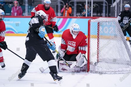 Stock Image of Ice Hockey 3on3 - Qualification Day 2, Junior Esposito (ARG/Black Team) scores against Goalkeeper Matthias Bittner (GER/Red Team).