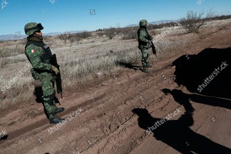 National Guard soldiers patrol near Bavispe, Sonora state, Mexico, where family members of the extended LeBaron family were ambushed by gunmen last year, one day before the expected arrival of Mexican President Andrés Manuel López Obrador, . The three women and six of their children, all U.S. citizens, were slaughtered and one of their cars burned here on Nov. 4, 2019