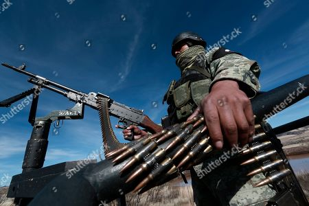 A National Guard soldier stands guard near Bavispe, Sonora state, Mexico, where family members of the extended LeBaron family were ambushed by gunmen last year, one day before the expected arrival of Mexican President Andrés Manuel López Obrador, . The three women and six of their children, all U.S. citizens, were slaughtered and their cars burned here on Nov. 4, 2019