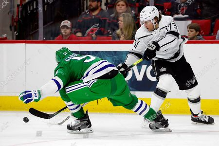 Los Angeles Kings' Tyler Toffoli (73) has his shot tipped away by Carolina Hurricanes' Jake Gardiner (51) during the first period of an NHL hockey game in Raleigh, N.C