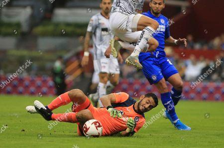 CP. Cruz Azul's goalkeeper Jesus Corona, bottom, blocks the ball under pressure from Atlas' Javier Correa during a Mexico soccer league in Mexico City