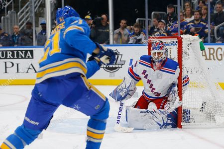 New York Rangers goaltender Henrik Lundqvist, of Sweden, defends a shot from St. Louis Blues' Jacob de la Rose, of Sweden, during the second period of an NHL hockey game, in St. Louis