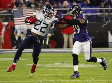 Tennessee Titans running back Derrick Henry (L) stiff-arms Baltimore Ravers Earl Thomas III (R) during the second quarter of the NFL American football AFC divisional playoff game between the Tennessee Titans and Baltimore Ravens at M & T Bank Stadium in Baltimore, Maryland, USA, 11 January 2020.