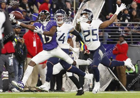 Baltimore Ravens wide receiver Marquise Brown (L) makes a one-handed catch in front of Tennessee Titans Kenny Vaccaro (C) and Adoree Jackson (R) during the second quarter of the NFL American football AFC divisional playoff game between the Tennessee Titans and Baltimore Ravens at M & T Bank Stadium in Baltimore, Maryland, USA, 11 January 2020.