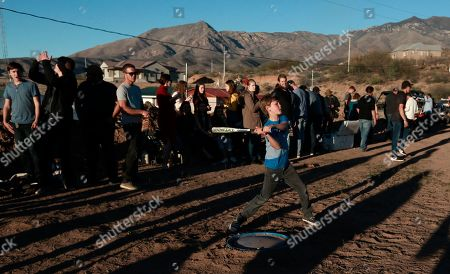 Boys play baseball in La Mora, Sonora state, Mexico, one day before the expected arrival of Mexican President Andrés Manuel López Obrador, . Three women and six of their children from La Mora, all U.S. citizens from the extended LeBaron family, were slaughtered and their cars burned by gunmen in this area on Nov. 4, 2019