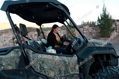 Stock Picture of Loretta Miller, mother-in-law of Rhonita Miller who was murdered with four of her young children, drives in La Mora, Mexico, one day before the expected arrival of Mexican President Andrés Manuel López Obrador, . Three women and six of their children from La Mora, all U.S. citizens from the extended LeBaron family, were slaughtered and their cars burned by gunmen in this area on Nov. 4, 2019