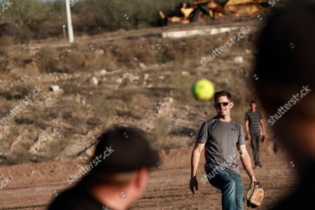 People play baseball in La Mora, Sonora state, Mexico, one day before the expected arrival of Mexican President Andrés Manuel López Obrador, . Three women and six of their children from La Mora, all U.S. citizens from the extended LeBaron family, were slaughtered and their cars burned by gunmen in this area on Nov. 4, 2019